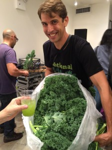 Dr. Drew Ramsey handing out kale on National Kale Day.